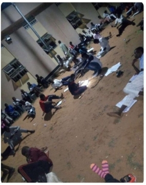 Photo Of Usman Danfodio University Students Reading Under The Moonlight